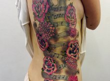 Roses and music notes tattoo