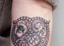 Heart and owl tattoo