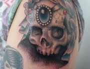 Skull and wreath tattoo