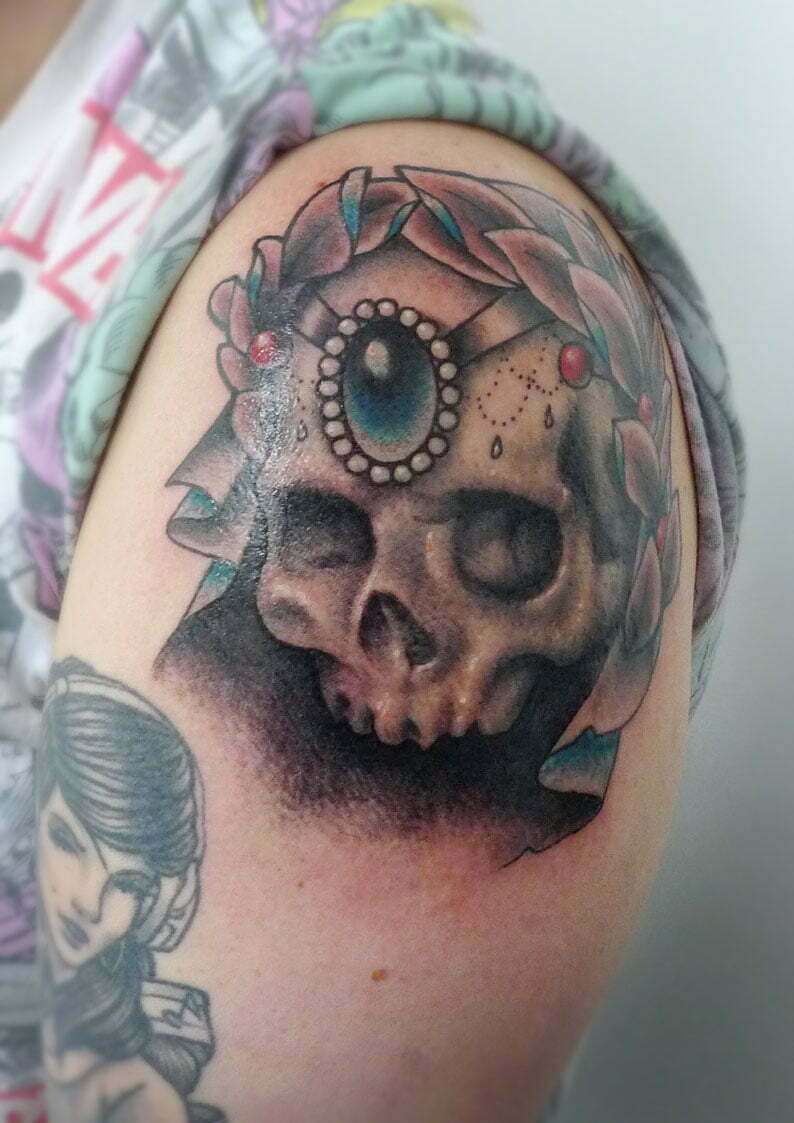 Skull and wreath tattoo